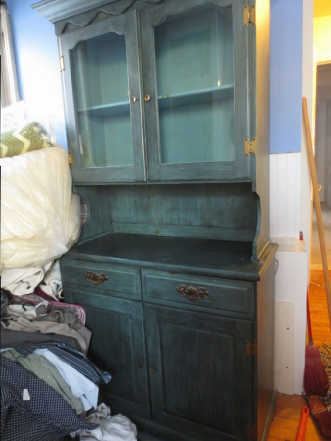 The bottom of the hutch has become a part of the linen closet; the top is going to be screwed to the laundry room wall.