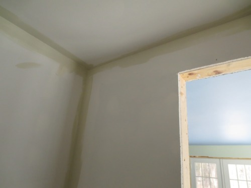 """The corners of the bathroom are painted the new """"Seed"""" color."""