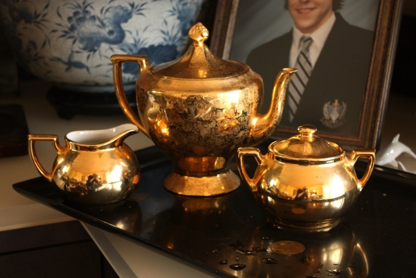 This lovely gold ceramic teapot, though perfect for making tea, will be used for decoration this time around.