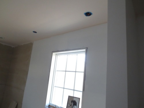 Pendant light will hang over the dual sinks on either side of the window.
