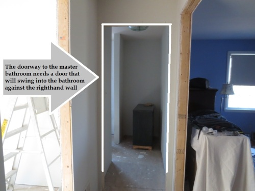 The master bathroom door actually shuts it off from the bedroom in the middle of the hall.  The layout is very private.