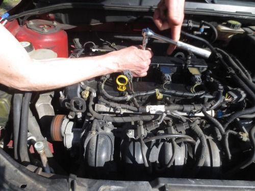 We also bought some deep-well socket wrenches to remove the spark plugs.