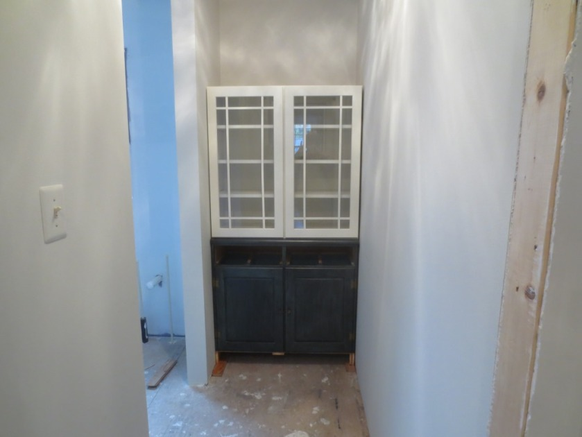 The 2 cabinets that make up the linen closet need to be painted and positioned correctly.