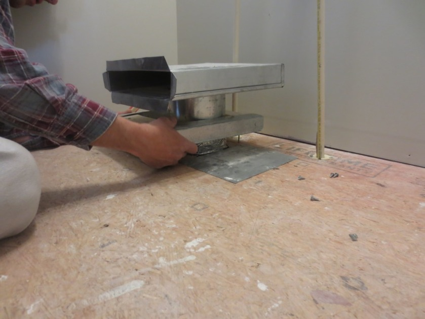 This toe-kick duct is used to redirect warm air under a cabinet. We removed this one.