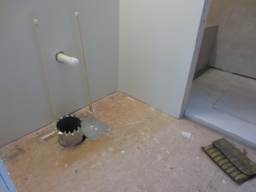 I hope this round duct will slide back down the hole after the floor is laid.