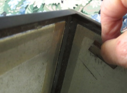Paint is easily scraped from glass with a razor blade.