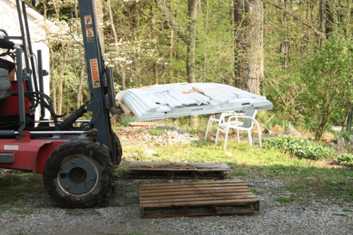 The plywood (which we'll need first) is on the bottom of the pile.