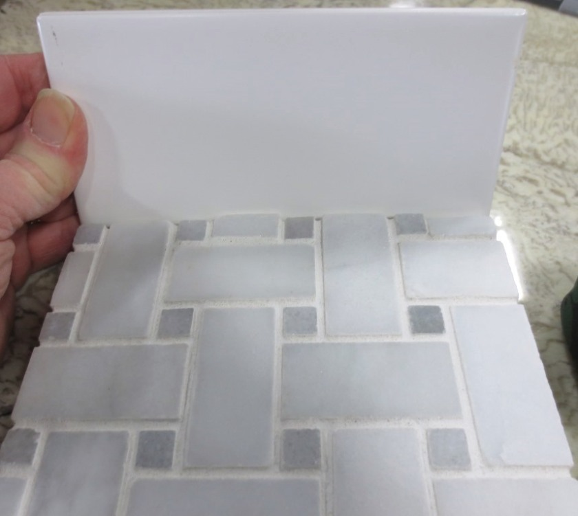 Marble basketweave tile for the floor and ice white subway for the shower walls.