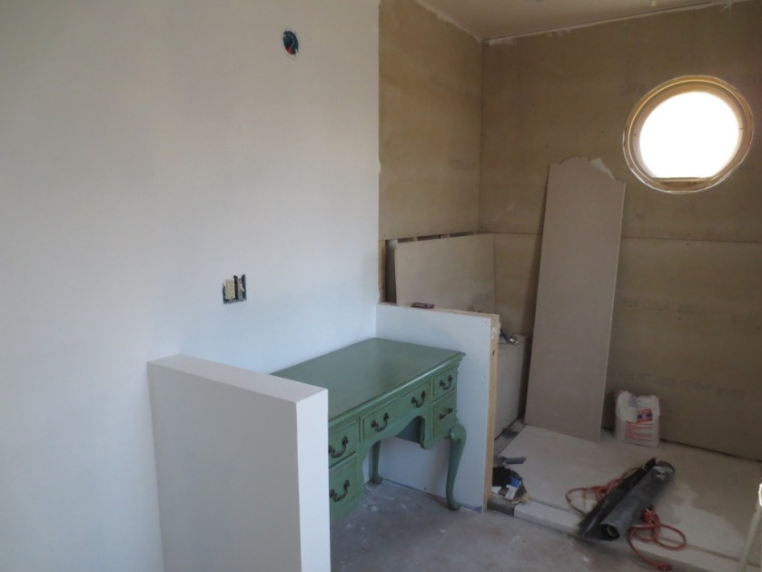 The master bathroom needs to be painted, a tile floor laid, and the shower walls tiled. $$$$