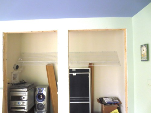 The back clips hold the shelf in place, either up or down, while the front brackets are installed.