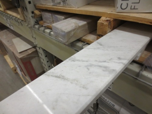 A long and wide marble threshold would look elegant at the bathroom entrance.