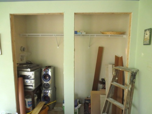 The conservatory closet has been drywalled, painted, and shelved.