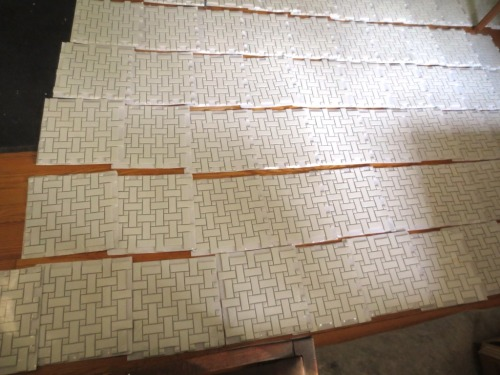 Charlie laid out all the tile for the conservatory bathroom to check for breakage and color differential.