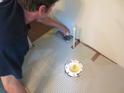Charlie trowels on the thin-set for under the Hardiebacker cement board.