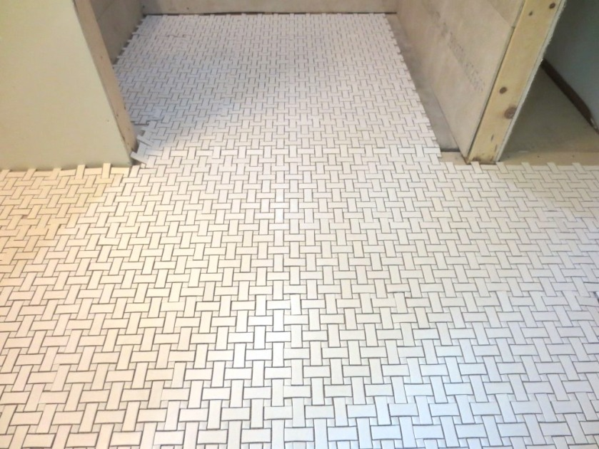 I hope the tillers start in the conservatory bathroom laying down the white basketweave tile.