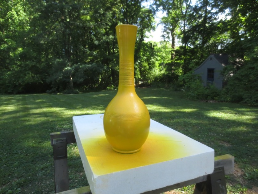 I painted and glazed this tall vase to match the olive tree planters.