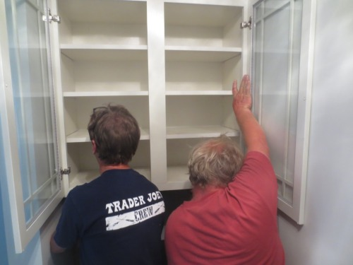 After getting the closet started in the up position each man wedged a carefully-cut 2 by 4 on each side.