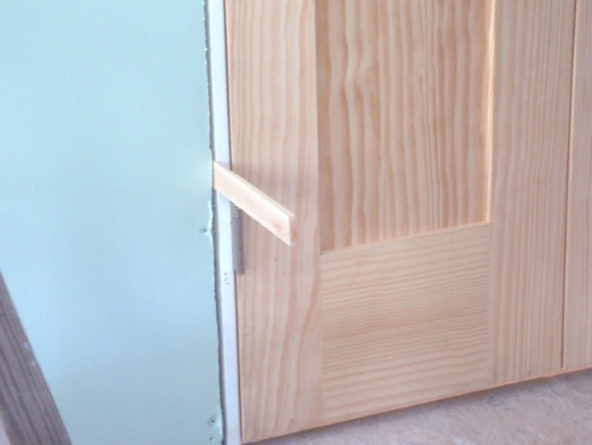 Shims are used to adjust the plumb of the door frame.