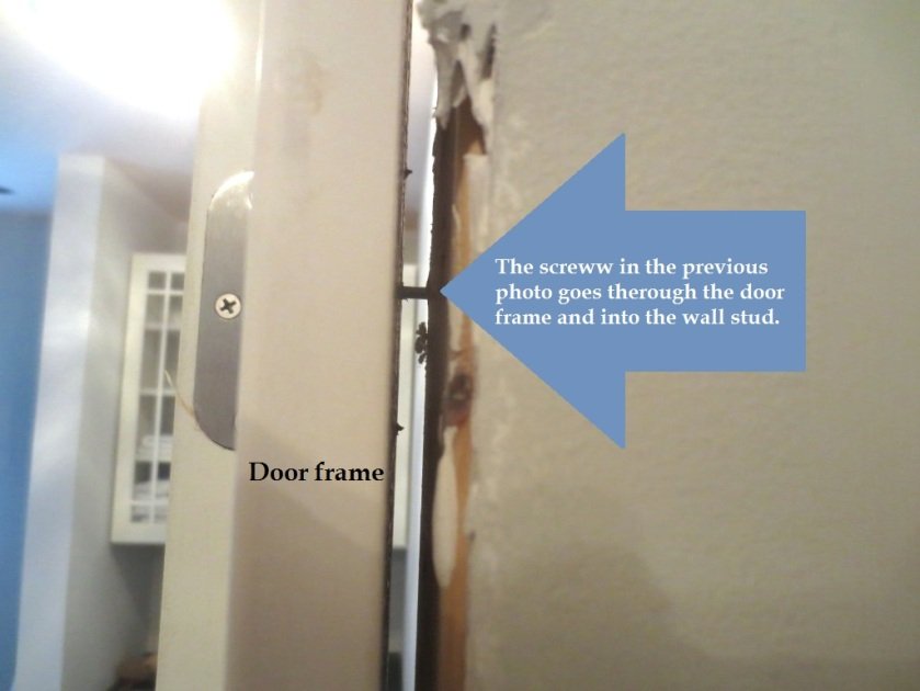 A long screw helps anchor the door frame.