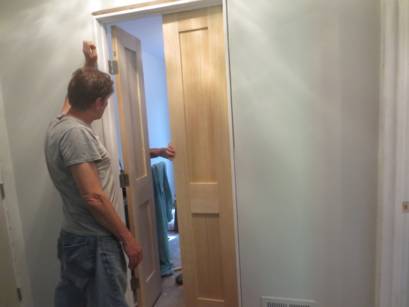 These closet doors will need knobs on both sides so we don't get trapped inside.