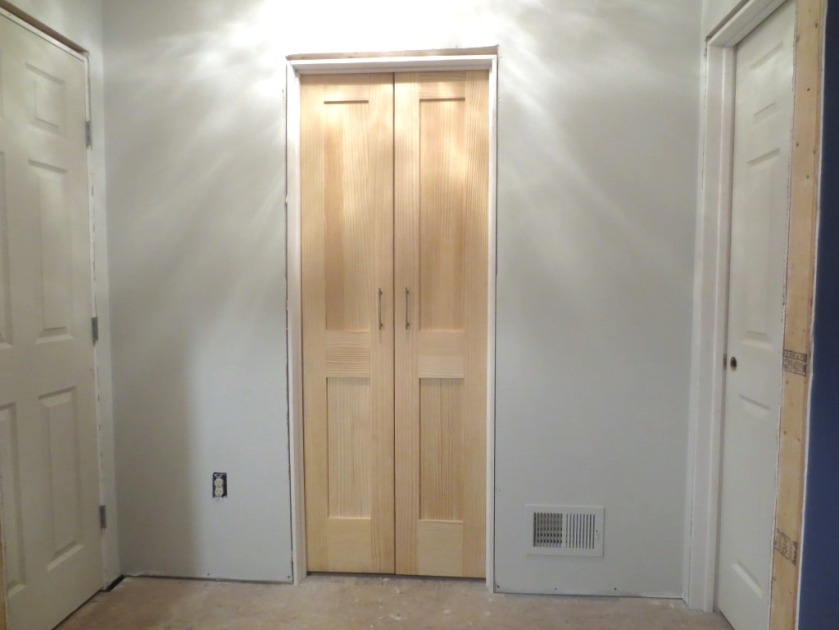 The Shaker-stile door on the master closet cost $267.02 and the door on the right $129.96.