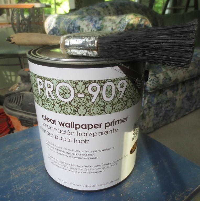 Wallpaper primer and paint brush