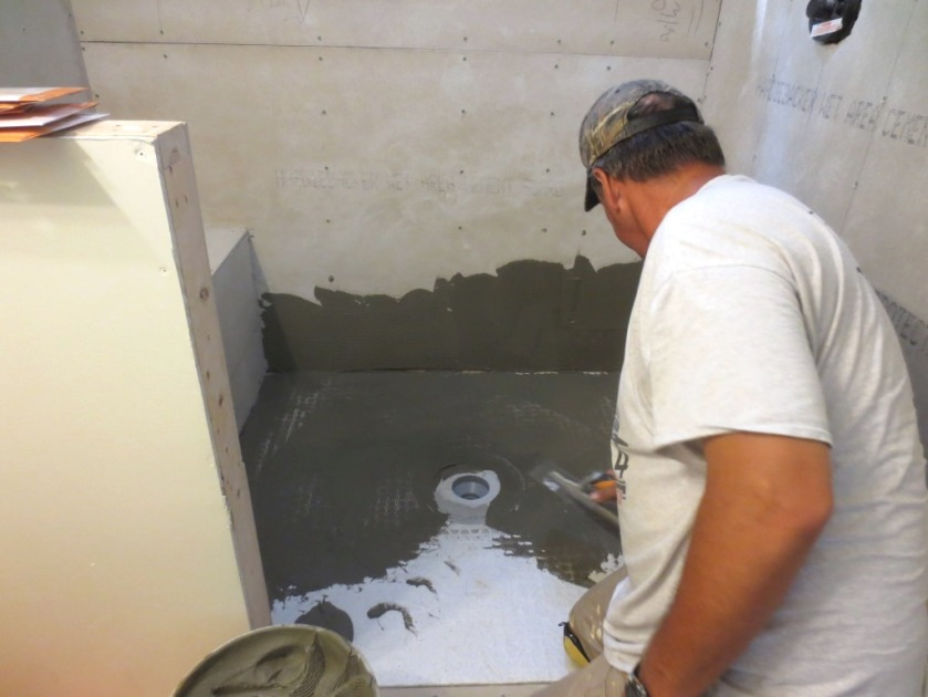 Our tile setter laying waterproofing membrane.