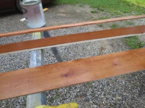 The bottom piece is stained luan, the center piece was not used, the top piece is polurethaned shoe molding.