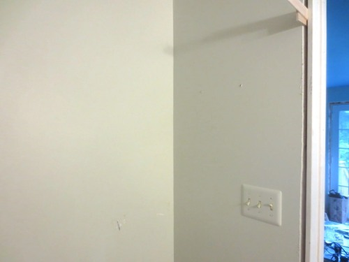 One of these two walls which already need touch-up paint will get a cabinet or art.
