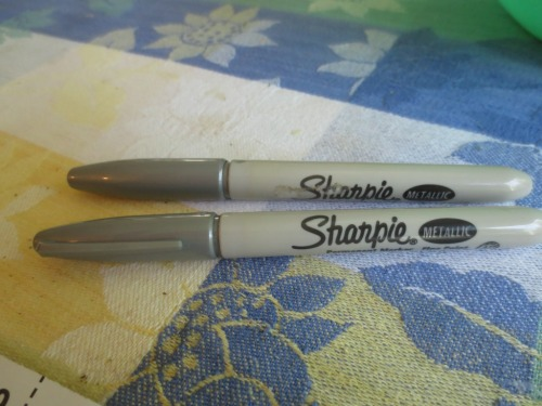 Silver Sharpies detail the blade with a pale but visible mark.