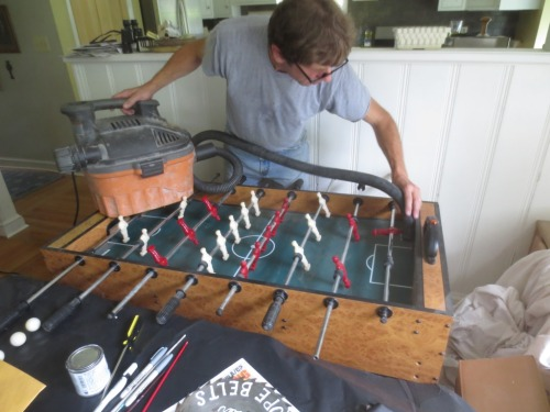 The foosball table is still in the dining room just under the area I want to paper.