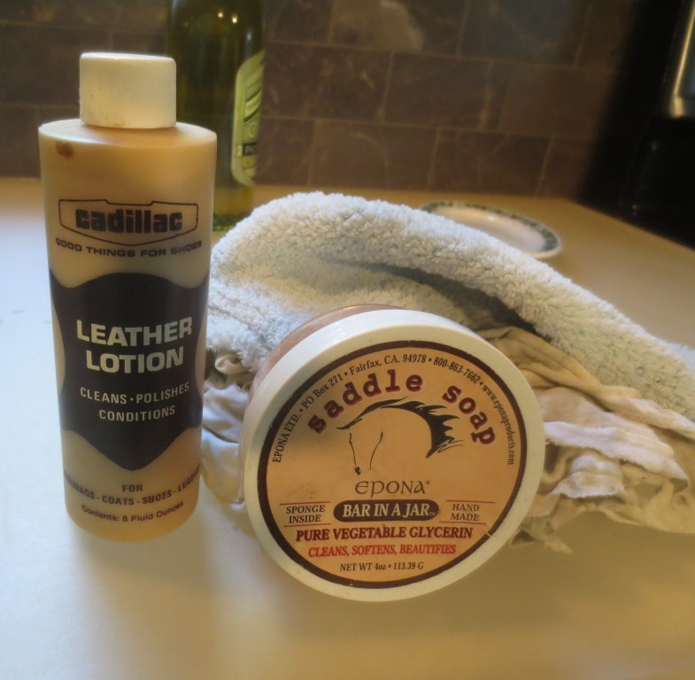 I used a damp rag with saddle soap to clean the leather.