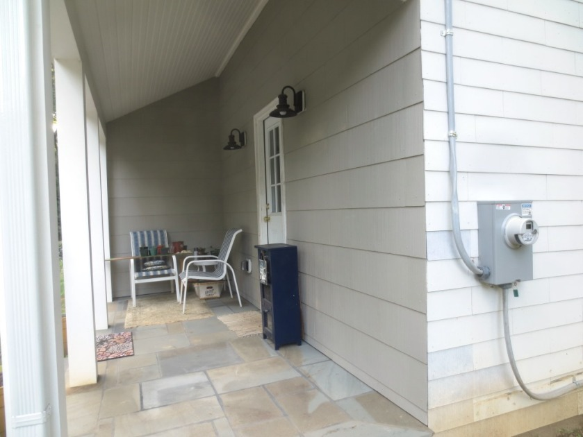 "The porch walls have been painted with ""Sandy Hook Gray""."