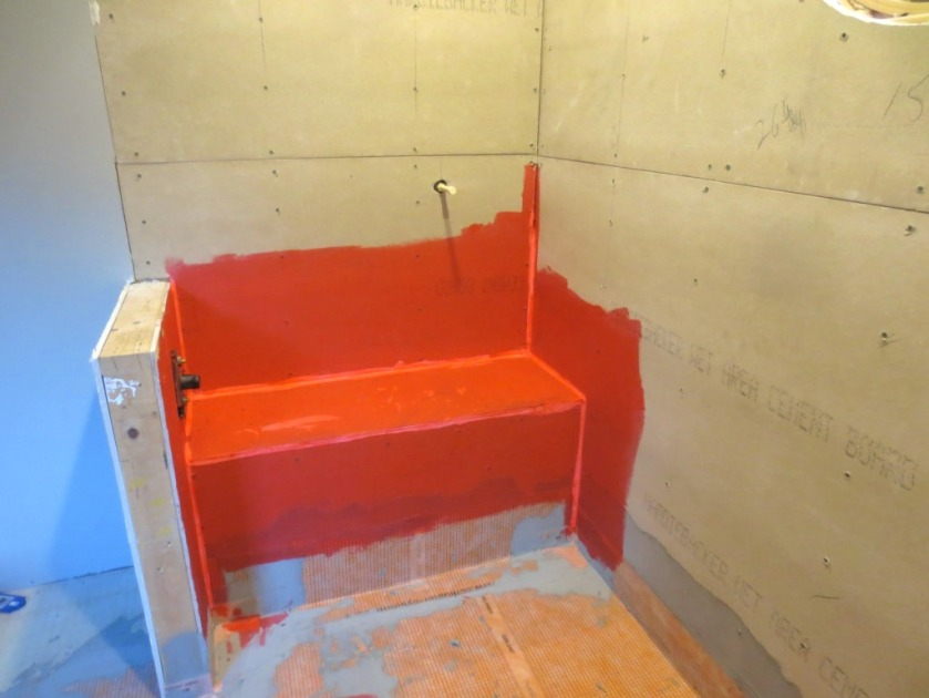 Waterproofed shower pan and bench in the master bathroom.
