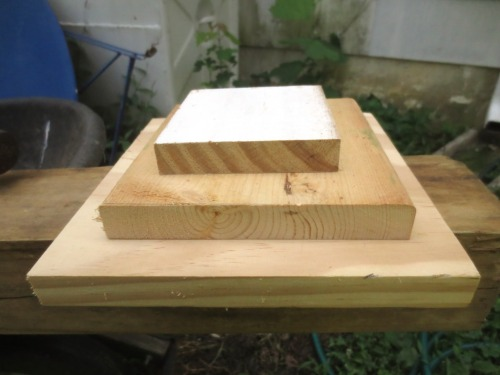 Graduated wood squares cut from various widths of lumber.