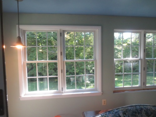 The window on the left is finished except for the mullion strip between the pair.