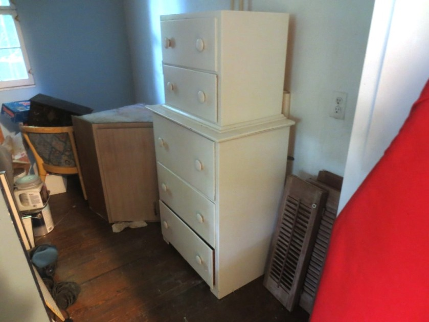 The white dresser is very lightweight and holds bulky items.