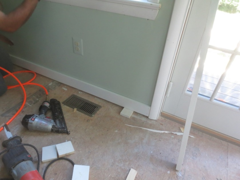 A spacer under the baseboard allows for future flooring.