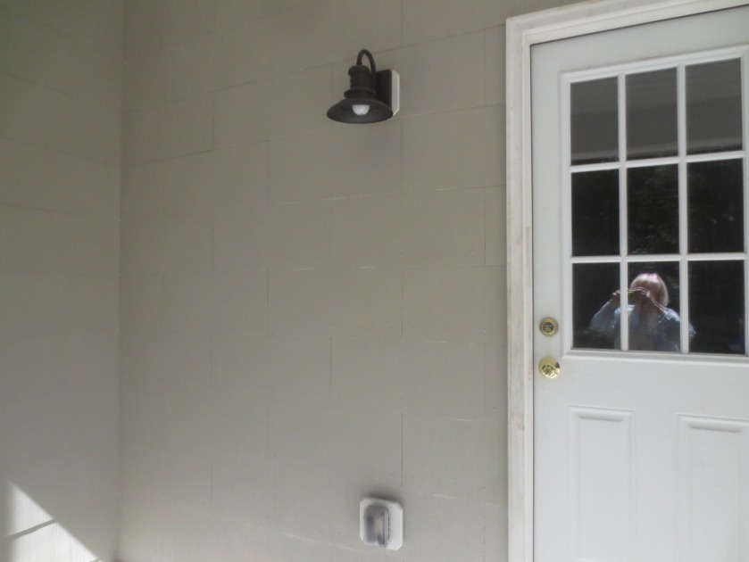 The side porch has been painted Sandy Hook Gray. That's me in my paint clothes in the reflection.
