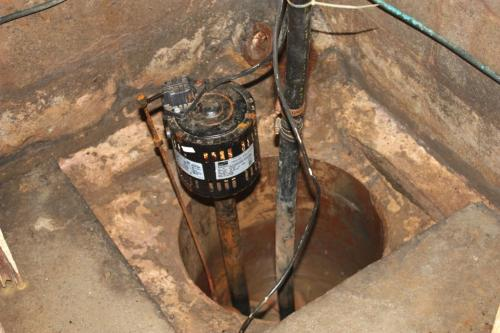 Sump pump in corner of basement keeps it dry. I don't have a photo of the new pump which replaced this relic last year.