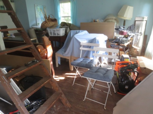 In addition to furniture and tool storage, The Cottage holds future projects like the French garden chairs.
