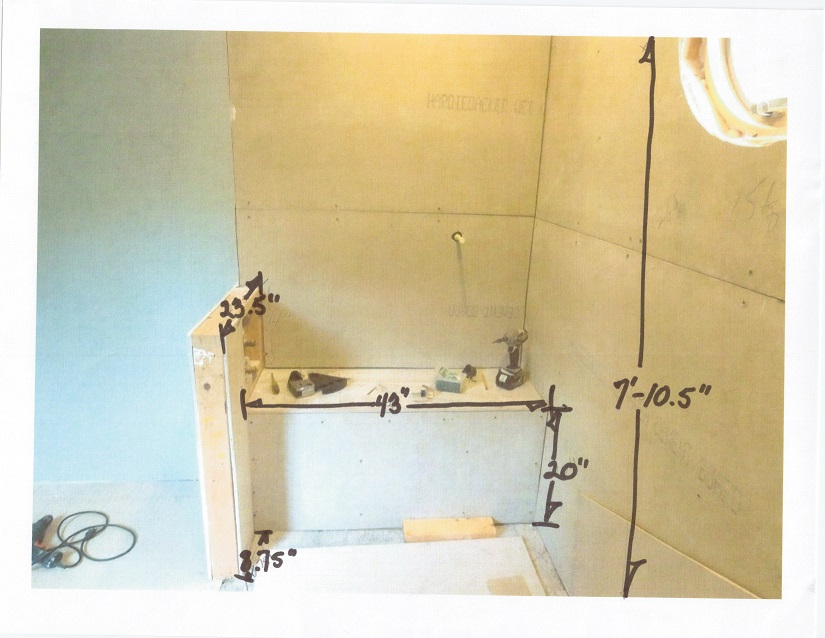 Perhaps the top of the knee wall and the shower seat should each be a single piece of tile or marble and have a decorative edge.