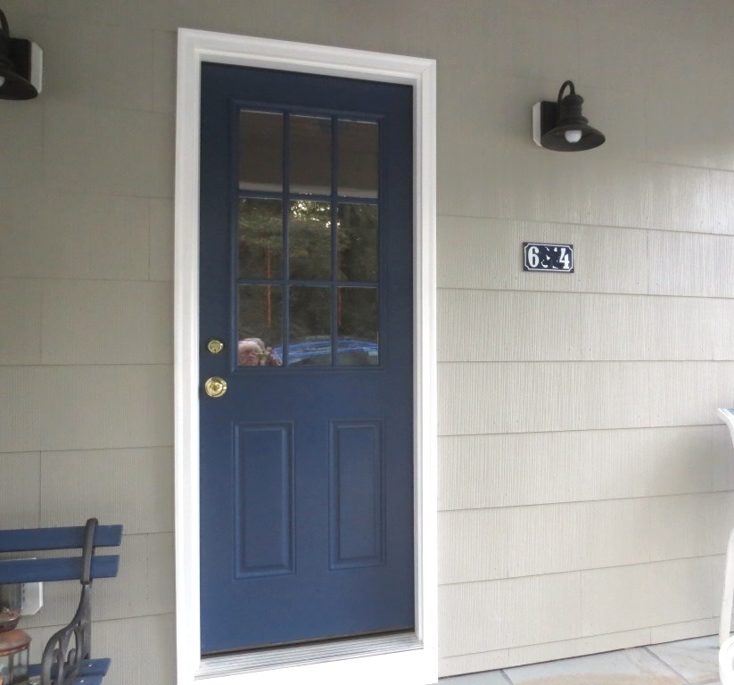 The sign on the porch is held up by Command strips.