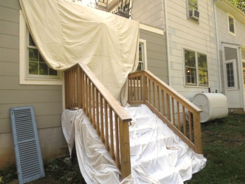 I covered the stairs with a piece of plastic and a drop cloth and I covered the French doors with another drop cloth hung from the porch above.