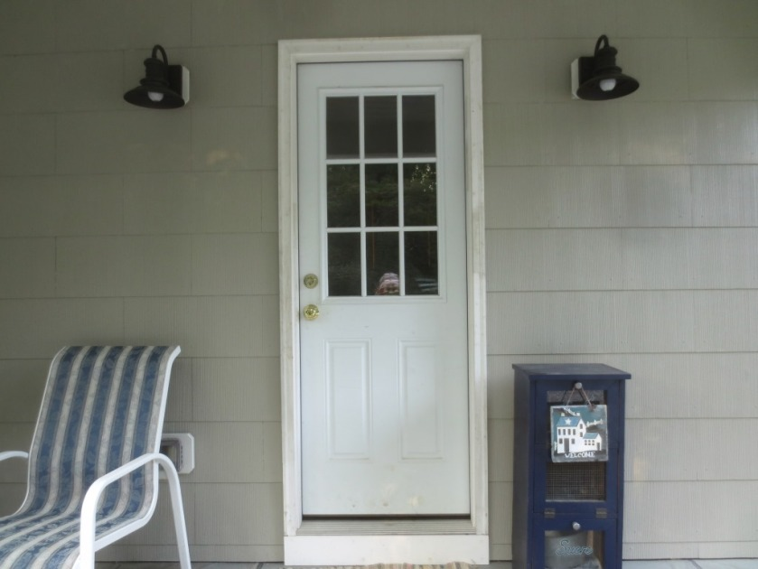 The side porch door unpainted was a pale greyish white.