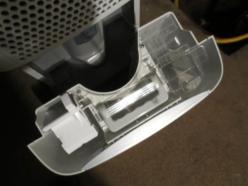 The front of the dehumidifier opens to reveal a water reservoir with its own handle.