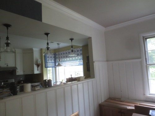 I need a boost to get the wallpapering finished. Every wall above the paneling gets wallpaper.