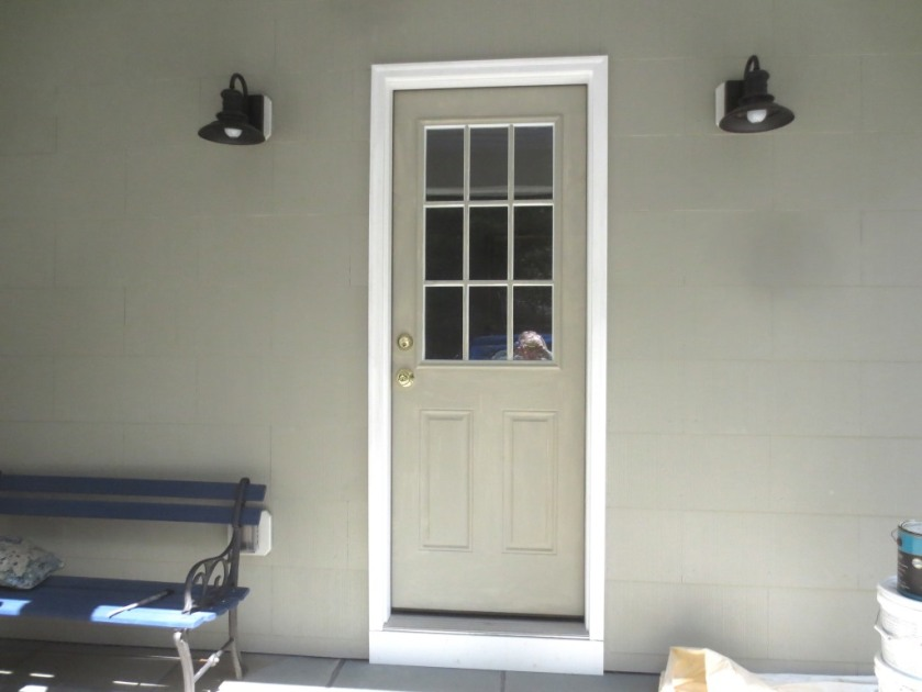 The side porch door painted Sandy Hook Gray.
