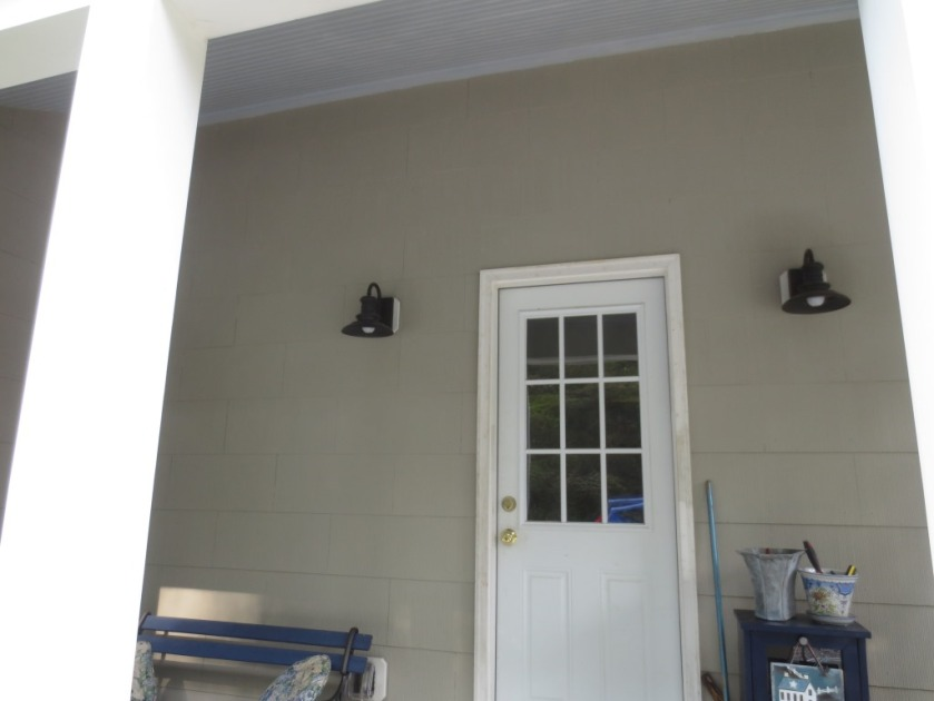 Both the walls and ceiling colors pick up tones in the bluestone deck.