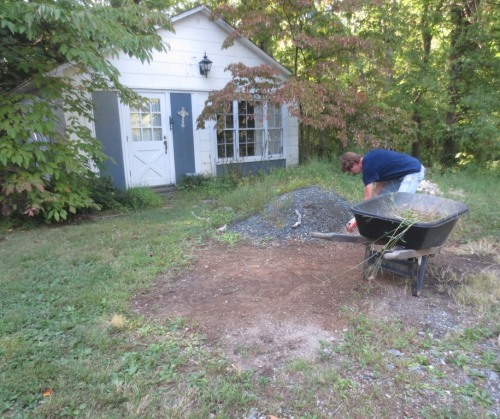 The last pile of crushed stone will be returned to the driveway.
